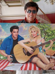 Ronnie McDowell shows off his painting of Elvis and
