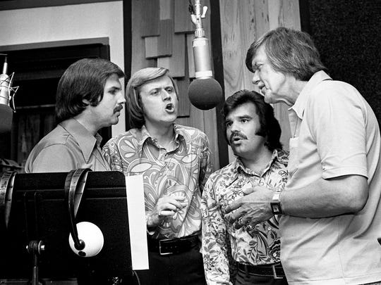Elvis Presley's concerts and recordings get a touch of gospel flavor from the Stamps Quartet, which consists of Bill Baise, left, Ed Enoch, Dave Rowland and J.D. Sumner. The quartet, Elvis' backup singers, perform during a recording session June 13, 1973, at the Hound's Ear Studio.