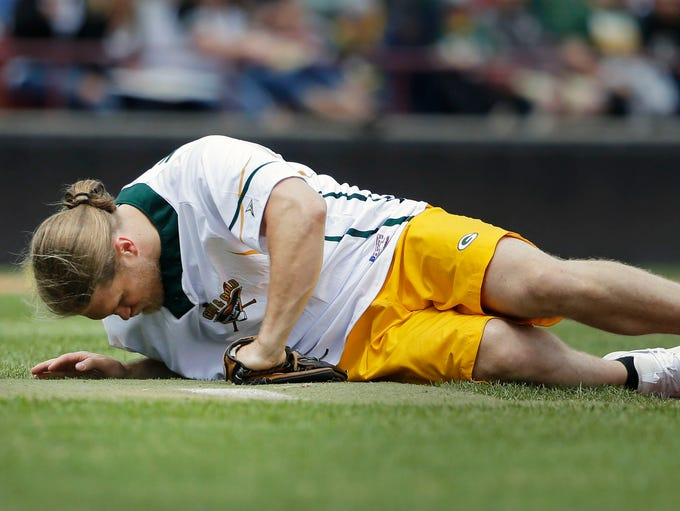 Clay Matthews is hit by a line drive as he pitches
