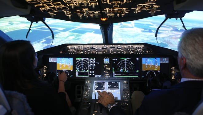 Boeing pilot George Walters shows the author how to operate the controls of a 787 at the manufacturer's new Dreamliner training facility in Miami.