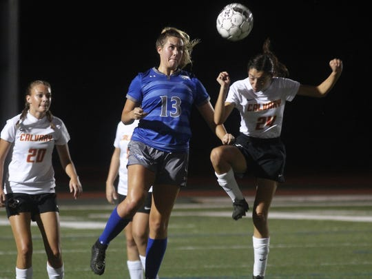 Scott senior Ashlyn Steward heads the ball during the