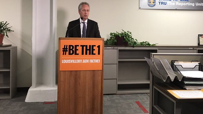 Louisville Mayor Greg Fischer demonstrates the LMPD tip line.