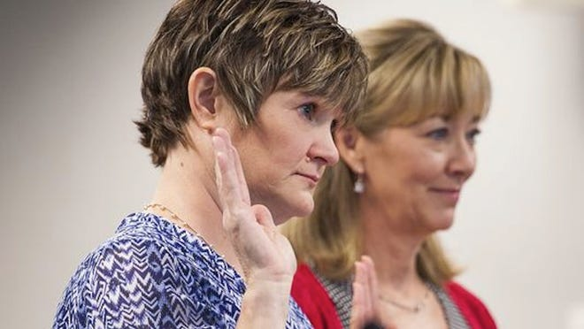 Julie Nowak (left) is sworn in before the Virginia Board of Nursing during her license hearing in Richmond on Sept. 18, 2014.