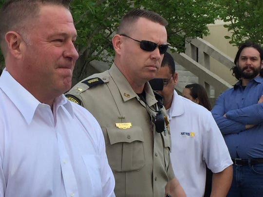 Lafayette City Marshal Brian Pope is escorted to jail