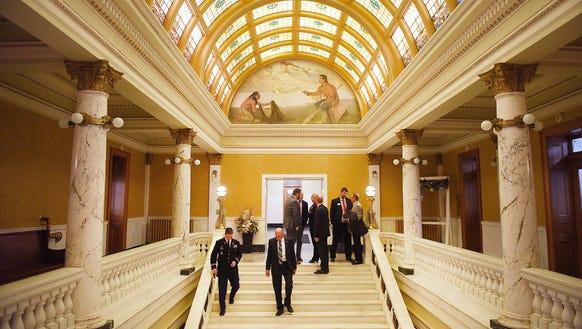 Legislators shake hands as they end the annual budget
