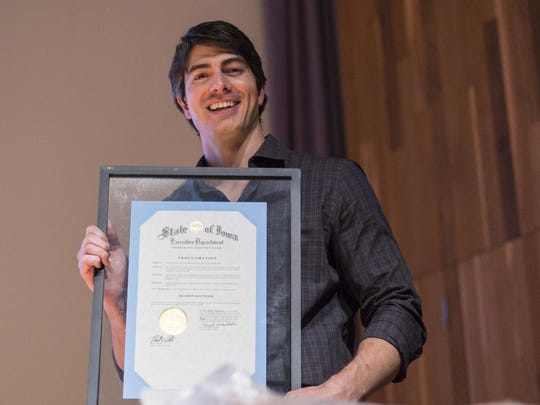 Norwalk native Brandon Routh receives a proclamation from Gov. Branstad at the State Historical Society of Iowa Friday June 12, 2015.