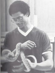 A 1980 photo of Francisco Espaillat holding a snake from a Lincoln yearbook.