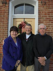 The Harvey One-Room School holiday open house, is all about people. From Left, Lisa Miller, her father Ron Hord, and Robert Gebhardt were among visitors the last time.