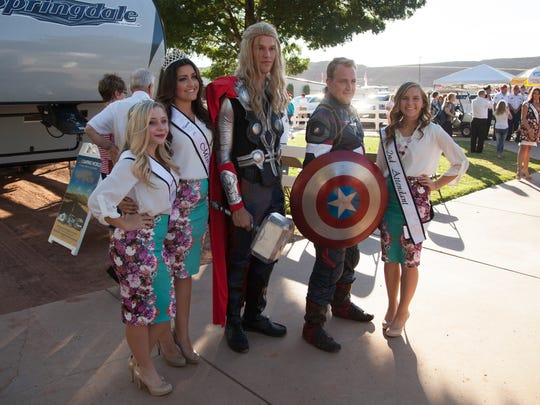 Marvel comic themed characters pose with city royalty at the start of the Washington County Fair Wednesday, Aug. 12, 2015.