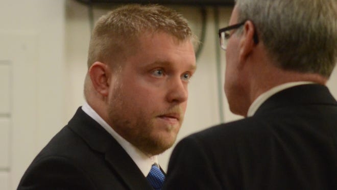 Ray Cole confers with his attorney, J. Thomas Schaeffer before Cole testified.