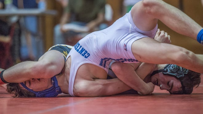 Hayden Busby of Centerville High School and Shane Lonneman of Milan compete in the consolation round for the 113 pound division at the IHSAA Richmond regional wrestling tournament at the Tiernan Center on Saturday, Feb. 3, 2018