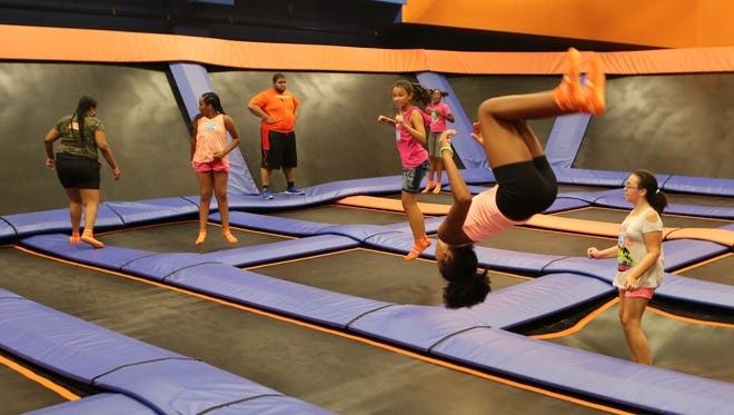 Isabella Usher, 9, from Bronxville, does a flip during the grand opening of the Sky Zone Indoor Trampoline Park at New Roc City in New Rochelle, Aug.13, 2016.