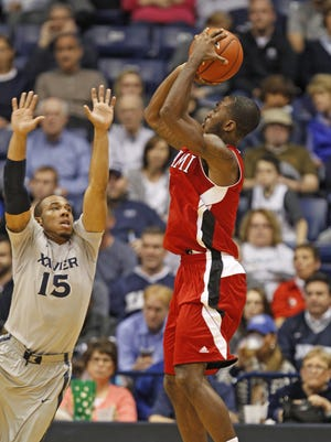 XU Miami basketball. Miami (OH) Redhawks guard Eric Washington (0) puts up a shot over Xavier Musketeers guard Myles Davis (15). Washington tied his career high 24 points against Kent State Feb. 24.