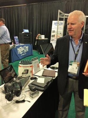 Synnex Vice President of Design and Support Services Kirk Nesbit shows off some of the latest educational tech tools available to teachers during the Synnex Inspire Conference Oct. 5 at the TD Convention Center in Greenville.