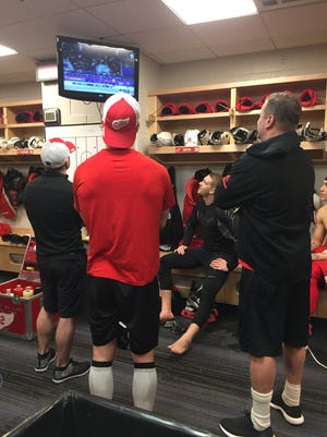 Red Wings players and trainers watch Olympic coverage in their locker room at Amalie Arena on Thursday, Feb. 15, 2018. Helene St. James, DFP.