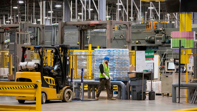 Bottled water is packaged for shipment at the Nestle Water bottling plant in Stanwood, Michigan, January 11, 2018. Global food conglomerate Nestle is in a battle with critics in tiny Osceola Township, Michigan where residents complain the Swiss company's water extraction techniques are ruining the environment.