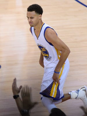 Stephen Curry mugs for the crowd after a big fourth-quarter bucket.