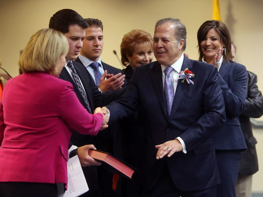 Lt. Gov. Kim Guadagno congratulates freeholder Thomas Mastrangelo after she swore him in to a new term at the Morris County Administration and Records building in Morristown. January 6, 2017, Morristown, NJ.