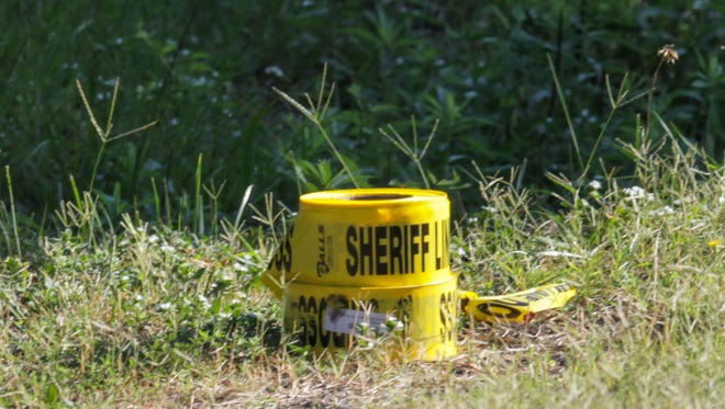 Crime scene tape rolls are on the ground near a line Anderson County Sheriff's Deputies put up around a home on Austin Drive in lower Anderson. A man was taken to AnMed Health Medical Center with non life-threatening injuries following a shooting Wednesday on Austin Drive in Anderson County.