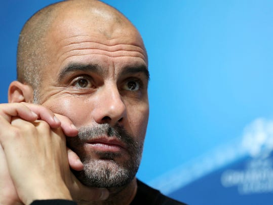 Manchester City manager Pep Guardiola during a press conference at the City Football Academy, Manchester, England Monday Oct. 16, 2017. Manchester City will play Napoli in a Champions League soccer match in Manchester on Tuesday.  (Martin Rickett/PA via AP)