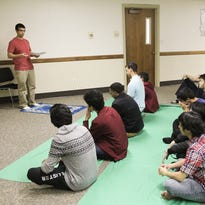 Mohammed Ismail leads a prayer service with the University of Iowa Muslim Student Association in the Lucas Dodge Room at Iowa Memorial Union Friday, Nov. 20, 2015.