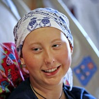 Doyel: Her season lost to cancer, Roncalli athlete runs one last race — for Audrey