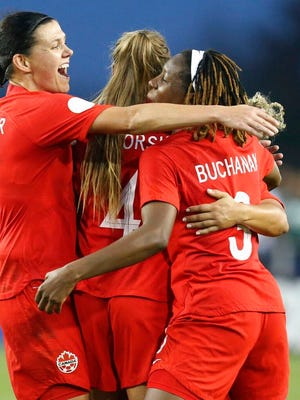 Canada's Christine Sinclair (19) and teammates Shelina Zadorsky(4) and Kadeisha Buchanan (5) celebrate a goal during a CONCACAF women's Olympic qualifying soccer match against Mexico, Tuesday, Feb. 4, 2020, in Edinburg, Texas.