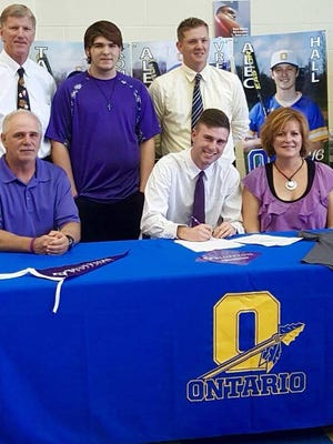 Ontario pitcher Ridge Jackson signed his letter of intent to play at Bluffton University on Monday.