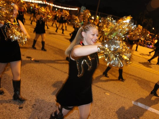 Janel Rinehart and her Fort Myers High School bandmates march in the 2016 Edison Festival of Light Grand Parade.