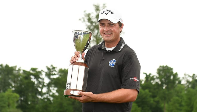 Brian Stuard celebrates with the trophy following a two-hole playoff to win the Zurich Classic at TPC Louisiana on May 2, 2016 in Avondale, La.