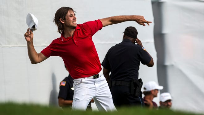 Aaron Baddeley throws his hat after sinking the winning putt for the Barbasol Championship in a four-hole playoff on Sunday, Jul. 17, 2016 at RTJ Grand National in Opelika, Ala.