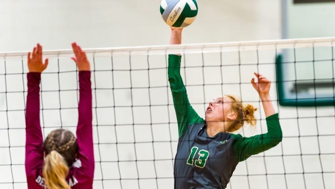 Emma Young at the net as Acadiana takes on Destrahan in the first round of the LHSAA Volleyball Playoffs. Thursday, Nov. 1, 2018.