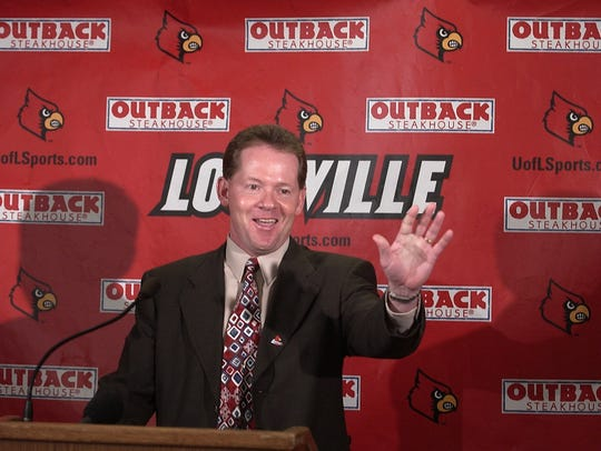 Bobby Petrino waves during his introductory press conference in December 2002.