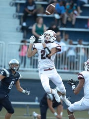 Henderson County's Max Hargis (24) nearly comes up with an interception against Reitz at the Reitz Bowl Friday night.