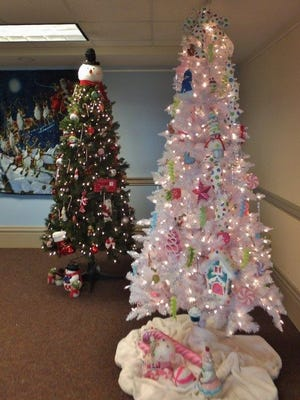 Decorated Christmas trees are the focus of the Davis Shai House's Christmas Celebration Saturday.