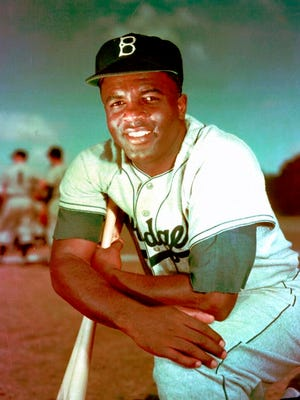 From 1952, Brooklyn Dodgers baseball player Jackie Robinson poses. Forced from the field by the new coronavirus, Major League Baseball is moving its annual celebration of Jackie Robinson online. The Jackie Robinson Foundation is launching a virtual learning hub to coincide with the 73rd anniversary Wednesday, April 15, 2020, of Robinson breaking the major league color barrier.