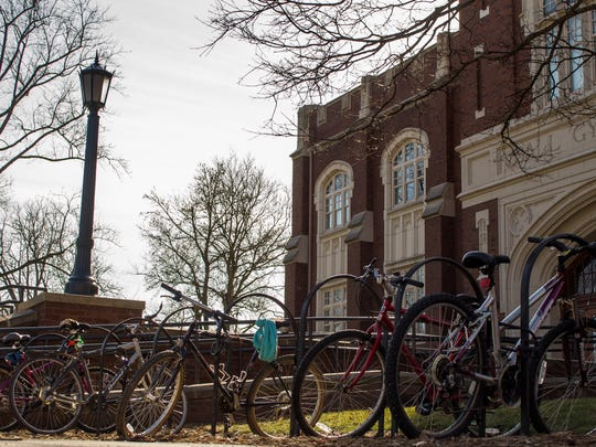 Bikes are parked outside Ball Gym at Ball State University.