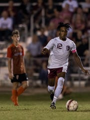 Henderson's Cartel Gilbert (12) dribbles down the field against the Hopkinsville Tigers at Colonel Field in Henderson, Ky., on Tuesday, Sept. 19, 2017. The Colonels and the Tigers tied, 5-5.