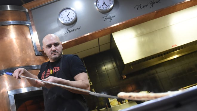 Vito Serradella, owner of Wood Fire Italian Grill prefers to use a brick oven with real wood for not only pizza, but for many of his dishes.