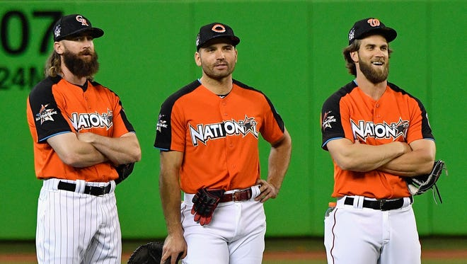 Charlie Blackmon of the Colorado Rockies, Joey Votto of the Cincinnati Reds and Bryce Harper of the Washington Nationals stand in the outfield during batting practice for the 88th MLB All-Star Game at Marlins Park on July 11, 2017 in Miami, Florida.
