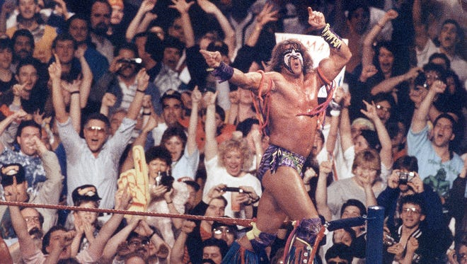 The Ultimate Warrior jumps into the ring during the WWF  WrestleMania VIII at the Hoosier Dome in Indianapolis on April 5, 1992.