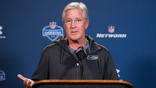 Seattle Seahawks head coach Pete Carroll talks with reporters during a news conference at the NFL football scouting combine at Lucas Oil Stadium in Indianapolis, Friday, Feb. 20, 2015.