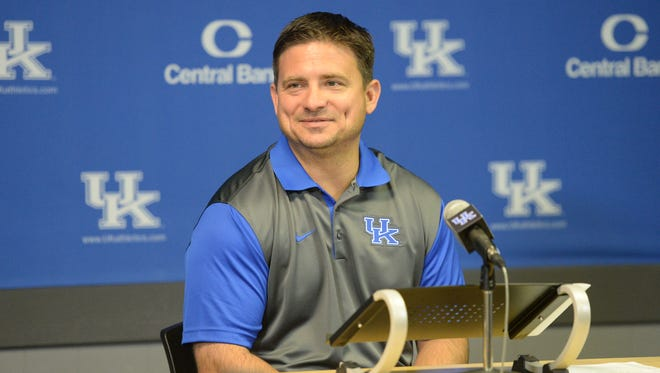 Offensive Coordinator Shannon Dawson answers questions during the University of Kentucky Football media day at Commonwealth Stadium in Lexington, Ky., on August 7, 2015. Photo by Mike Weaver