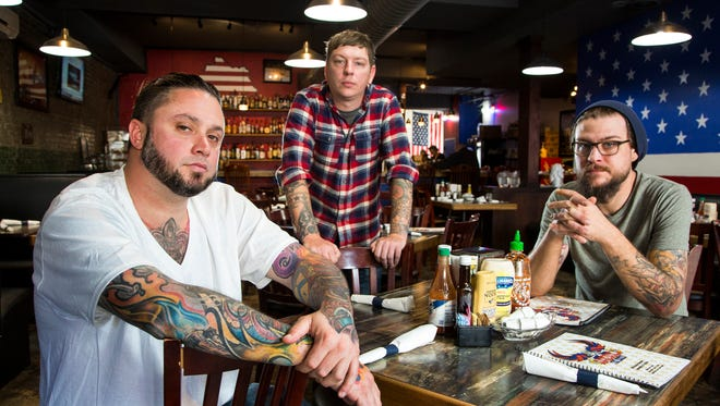 Chefs Dustin Staggers, Eric Morris and Ethan Ray pose for a portrait at America. The Diner.