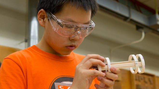 Ithaca High School ninth-grader Tilden Chao works to create a prototype for a biotechnology project. Chao is a member of the Ithaca chapter of the Technology Student Association at Ithaca High School.