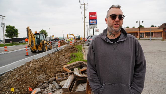 David Rynes, owner of King Davids Tattoo, discusses the construction work taking place in front of his business Monday, May 9, 2016, at 710 Sagamore Parkway. Rynes said he's not opposed to the project, but the construction work on Sagamore Parkway has put a dent in his business.