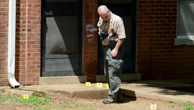 Jackson Police officials investigate a shooting at Allenton Heights, Friday afternoon. One man was taken to the hospital in non-life threatening condition.
