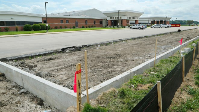 New parking space under construction Monday, July 25, 2016, at East Tipp Middle School. Tippecanoe School Corp. is moving some of the sports fields and switching over the water water treatment in phase 1 of a project to bring East Tipp up to par with other middle schools. Additional parking in front of the school and new school signage is also part of the project.