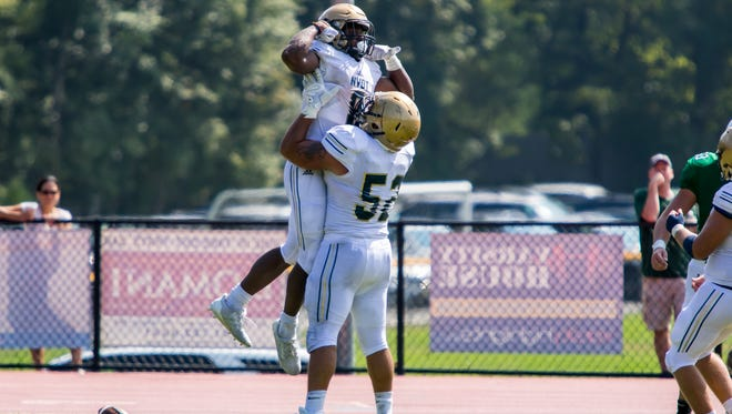 NV/Old Tappan's Marquez Antinori (8) being lifted in the air to celebrate after a touchdown on Saturday, Sept. 16, 2017. The running back rushed for 141 yards on 15 carries and had two touchdowns.