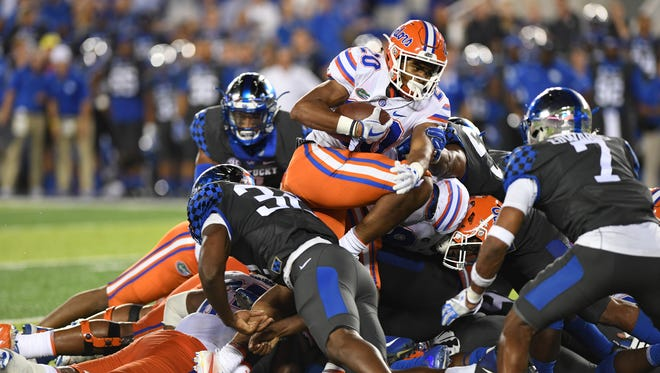 UF RB Malik Davis runs for a first down on 4th and inches during the University of Kentucky football game against University of Florida in Lexington, KY on Saturday, September 23, 2017.